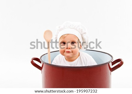 cute little baby  sitting in a huge pot  - stock photo