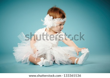 cute little ballerina on blue background