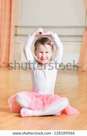 Cute little ballerina training at ballet class