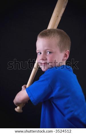 Cute little blond boy playing baseball. - stock photo