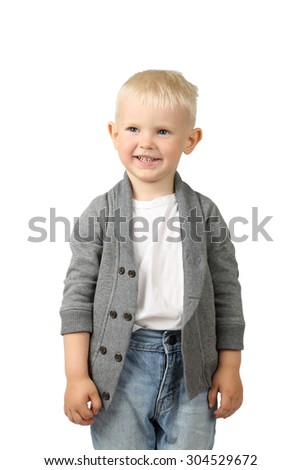 Cute little blond boy stands smiling isolated on white background - stock photo