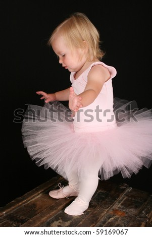 Cute little blond girl wearing a tutu and one ballet shoe - stock photo