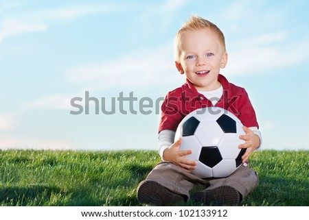 Cute Little Boy and holding his soccer ball - stock photo