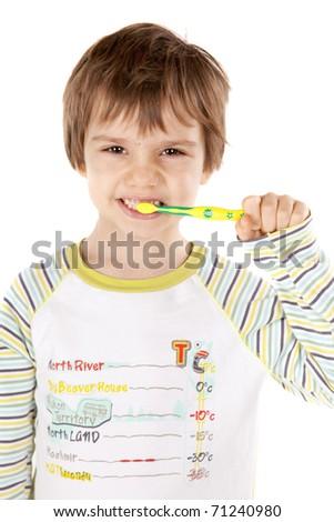 Cute little boy brushing his teeth - stock photo