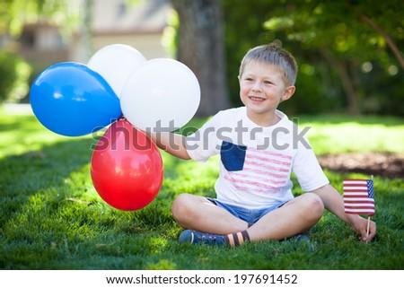 Cute little boy celebrating July 4th - stock photo