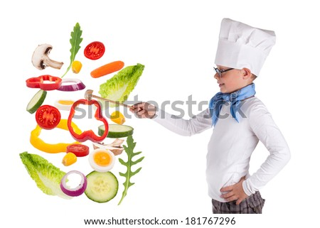 cute Little Boy Chef cook juggling with fresh vegetables, healthy eating concept  - stock photo