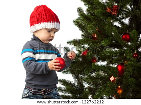 Cute little boy decorating Christmas tree - stock photo