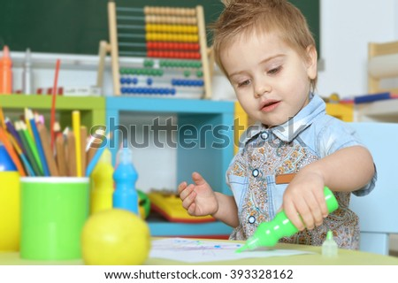 cute little boy drawing - stock photo