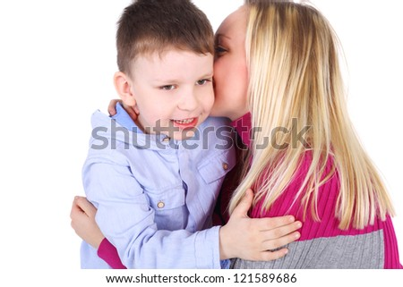 cute little boy embracing his beautiful mother - stock photo