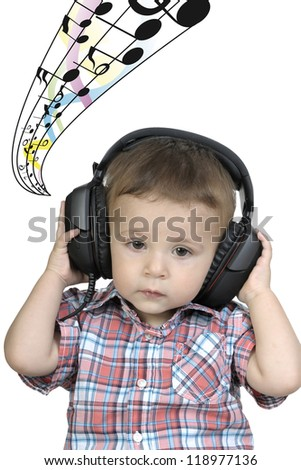 Cute little boy enjoying music