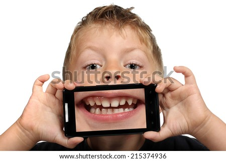 Cute little boy having fun with a selfie mouth on a white background - stock photo