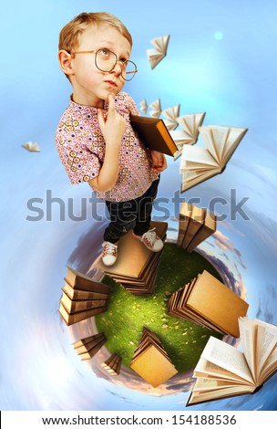 Cute little boy in glasses standing on abstract book planet - stock photo