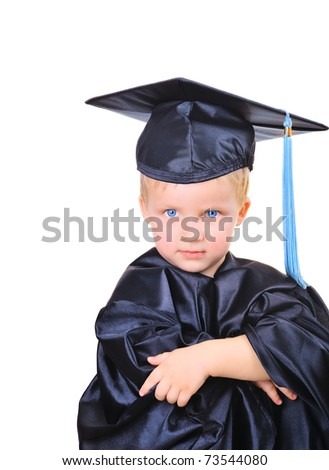 Cute little boy in graduation gown thinking