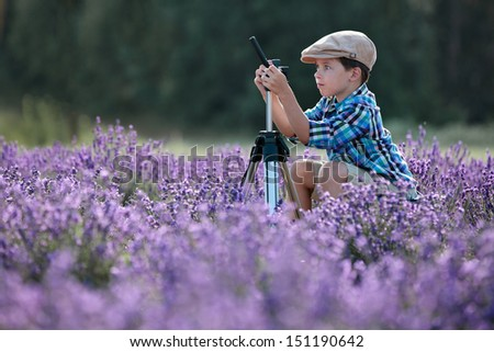 Cute little boy in lavender field - stock photo