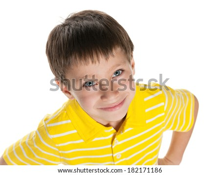 Cute little boy in yellow shirt on the white background