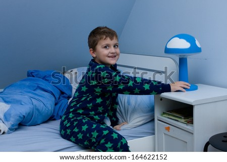 cute little boy just about going to sleep - stock photo