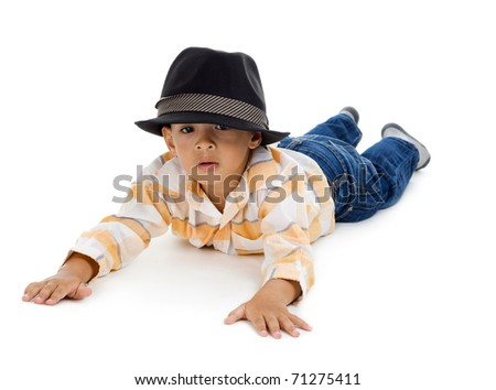 cute little boy laying on the floor, isolated on white background - stock photo