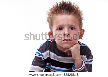 Cute little boy looking bored with his hand on his chin on a white background - stock photo