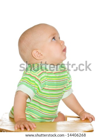 Cute little boy looking up with interest. Isolated on white - stock photo