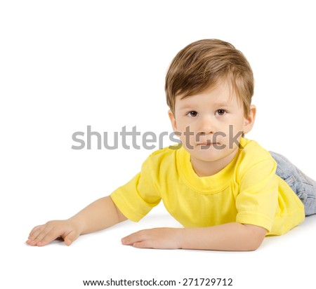 Cute little boy lying on the floor isolated on white background - stock photo