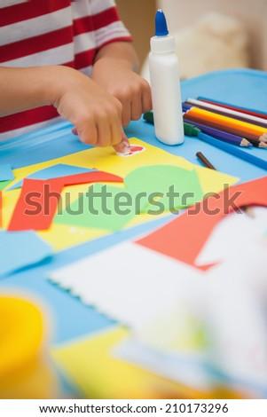 Cute little boy making art in classroom at the nursery school - stock photo