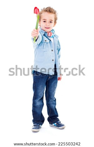Cute little boy offering a red tulip - stock photo