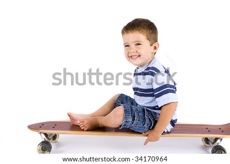 Cute little boy on a skateboard