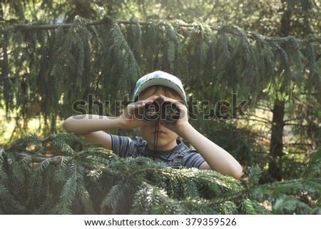 cute little boy playing with the binocular