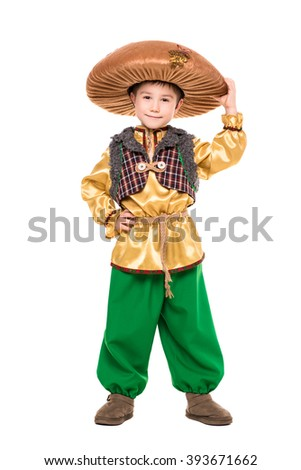 cute little boy posing in a mushroom costume isolated on white