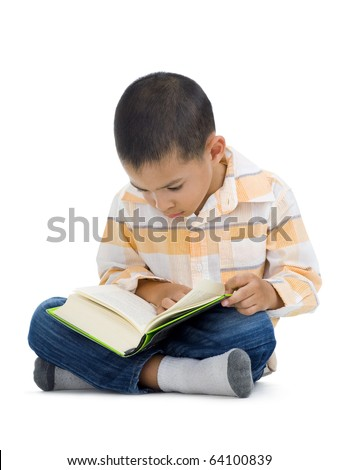 cute little boy reading a book, isolated on white background