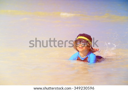 cute little boy relax on summer tropical beach