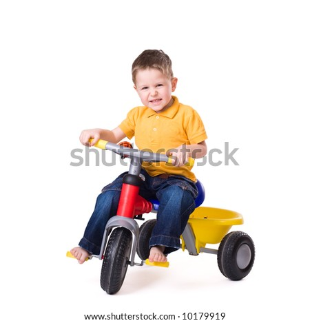 Cute little boy riding a 3-wheel bike. Isolated on white background