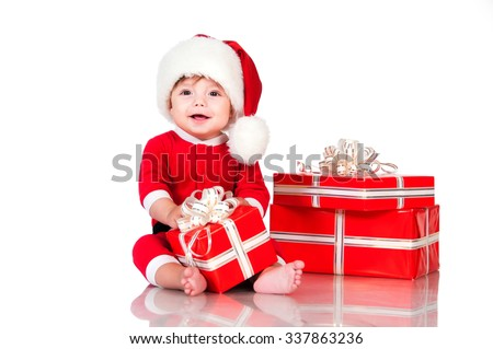 Cute little boy Santa  with gift boxes on a white background. Happy  New Year  and christmas holidays - stock photo