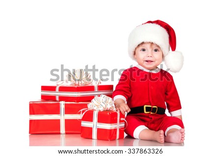 Cute little boy Santa  with gift boxes on a white background. Happy  New Year  and christmas holidays