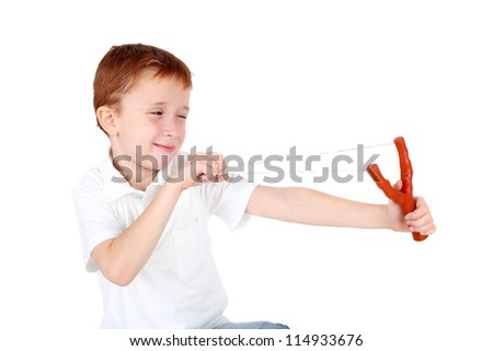 cute little boy shooting from a slingshot - stock photo