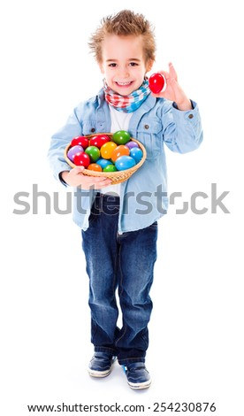 Cute little boy showing an red Easter egg - stock photo