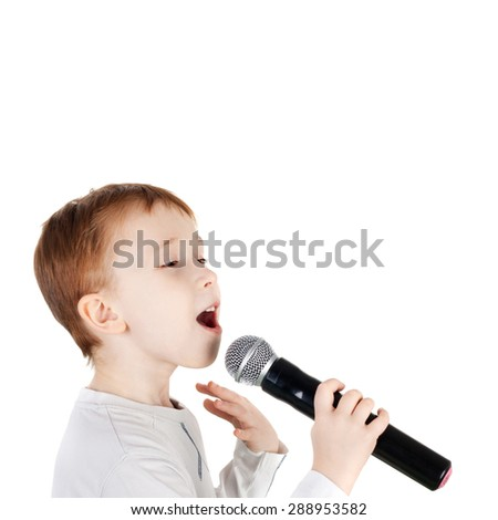 cute little boy singing with the microphone - stock photo