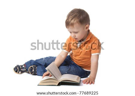 Cute little boy sitting with book and reading, isolated on white background. concept.