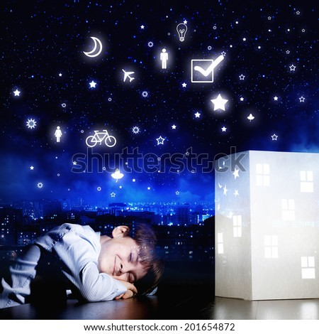 Cute little boy sleeping and dreaming about home - stock photo