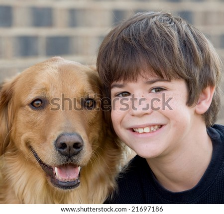 Cute Little Boy Smiling With Dog - stock photo