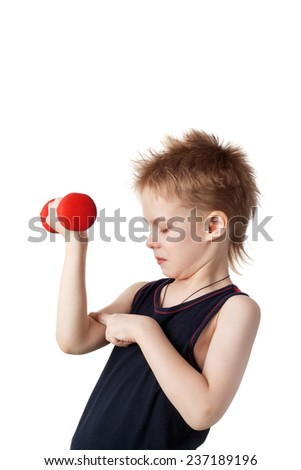 cute little boy training with the dumbbells inspecting his muscles - stock photo