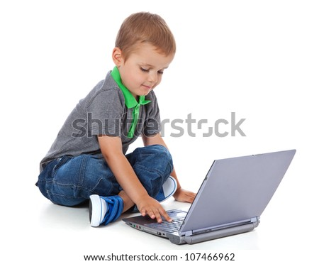 Cute little boy using laptop. All on white background. - stock photo