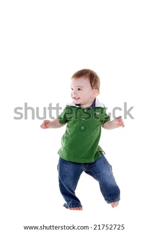 Cute little boy wearing a green top and jeans dancing. - stock photo