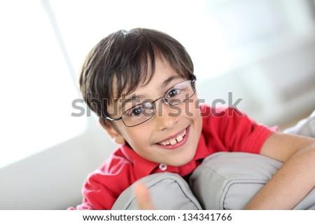 Cute little boy wearing eyeglasses - stock photo