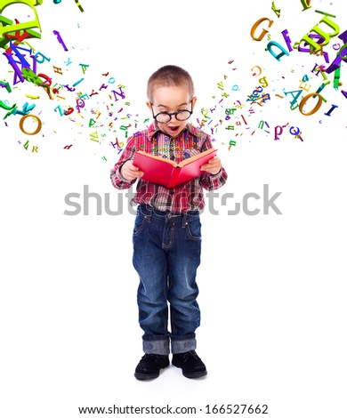 Cute little boy wearing glasses, wondering of flying letters from a tale book - stock photo