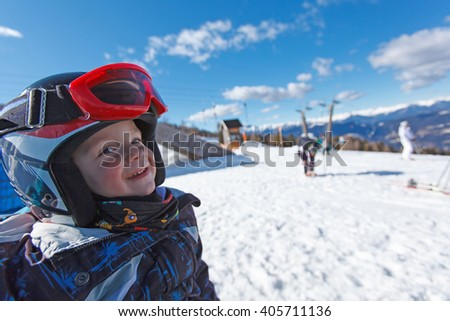 Cute little boy while skiing in the Austrian Alps.