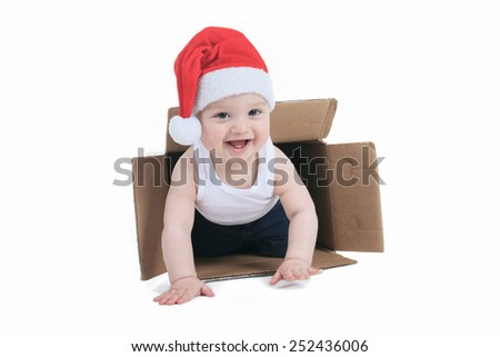 cute little boy with christmas hat into a box - stock photo