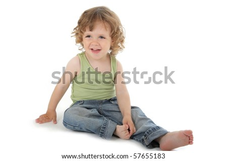 cute little boy with curly hair sitting and laughing studio shot on white