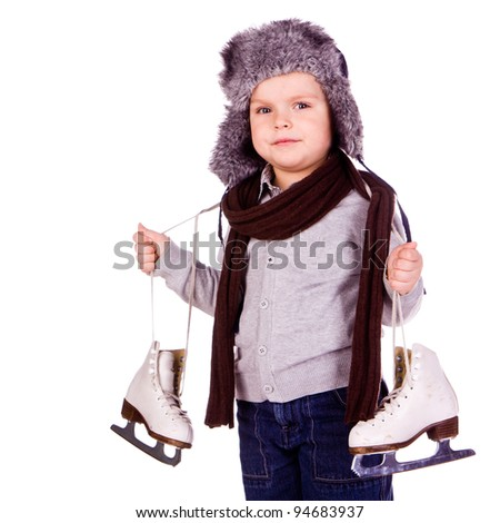 Cute little boy with figure skated isolated over white backgound - stock photo