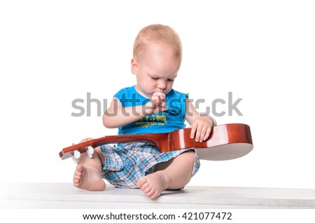 Cute little boy with guitar isolated on white background - stock photo